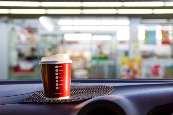 convenience store coffee sitting on car dashboard