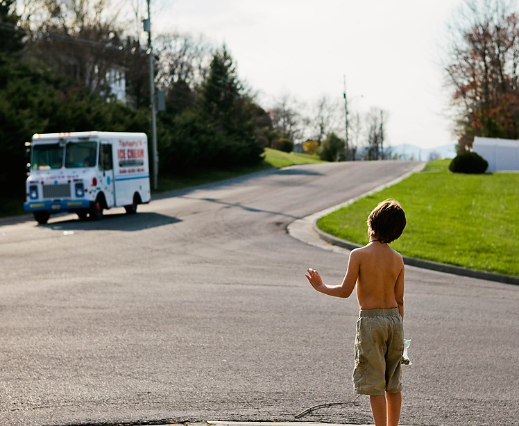 boy waiting for ice cream truck